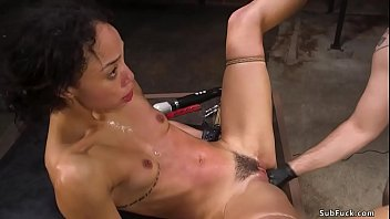 Hot ebony slave Alexis Tae is tied over table by big dick master Tommy Pistol and gets brutally fisted then fucked with legs spreaded in the air