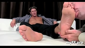 Aroused gay fellows in foot fetish romance at home