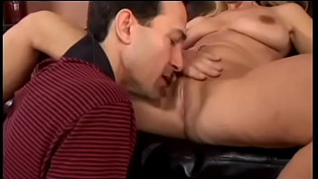 Blonde milf gets her pussy licked before she sucks a dick on the couch