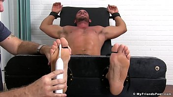 Bound hunk struggling with hard tickling