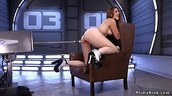 Redhead hottie shoving fucking machine in shaved pussy