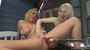 Small tits blonde helps huge tits Milf lesbian fucking machine then gets fist fucked