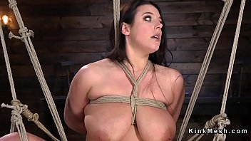 Busty brunette slave in rope bondage suspension gets her pussy fingered