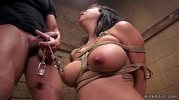 Asian slave with big tits gets whipped by her two masters