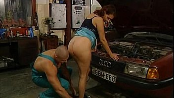 Mature woman is banged in a garage by mechanic