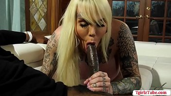Huge tits shemale thanks her black attorney for helping her on her court cases.As a thank you gift,she starts throating his big black cock passionately.After that,she lets him bareback her tight wet ass so deep and hard.