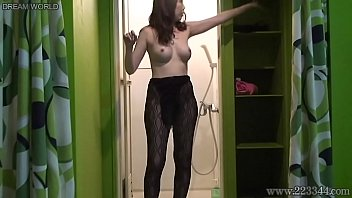 Aya Kisaki is takes off the fishnet stockings in the bathroom
