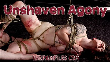 Bound submissive in strict leather strap punishment and caning while in upside down rope works in the dungeon
