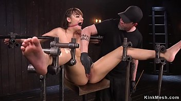 Hanged to a metal bar brunette hottie gets whipped