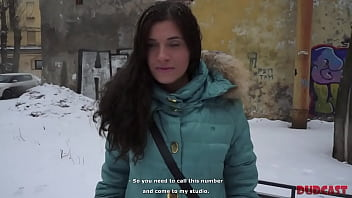 Tough Russian winter and beautiful girl sitting on the bench