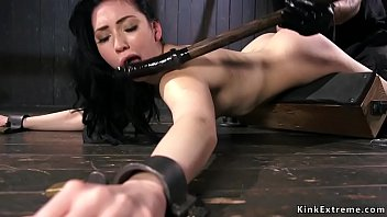 Strapped dark haired babe Aria Alexander with head locked in metal device gets gagged by her master