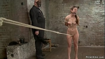 Baldheaded and masked master Sgt Major strips stunning brunette slave Serena Blair and then makes her to walk uncomfortable crotch rope on hogtie