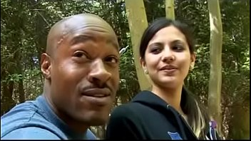 Tattooed Indian girl fucked by black guy in the forest