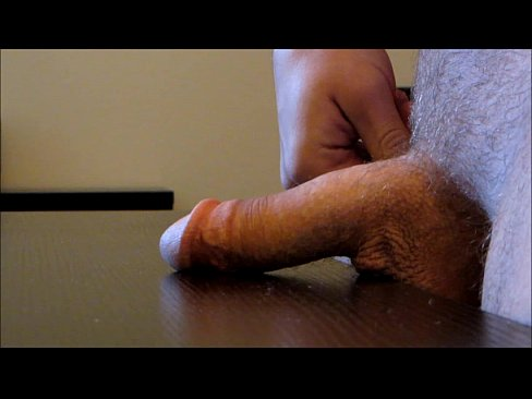 Solo cumshot on table