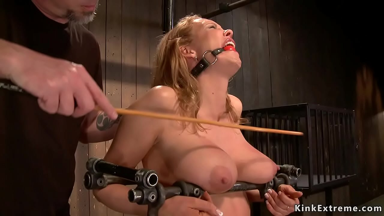 Sucking on her slave's tits