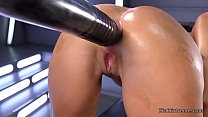 Hot brunette babe Roxy Raye strips off her blue thong and then gets huge dildo fucking machine in the ass Thumbnail