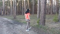 A mature exhibitionist undresses in the woods, ...