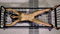 Girl stretched out on a metal cot and electrocu...