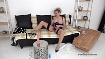 Busty mature strokes her dildo then uses her vi...