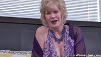 American gilf Justine feels horny in lingerie a...