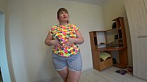 A doctor in medical gloves helps a BBW lesbian ...