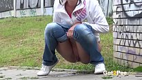 Pissing in Public - A nervous girl pees in fron...