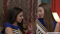 Teen cheersquad members experimenting licking e...