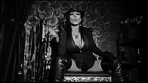 Mistress Kennya with long leather boots and cig...