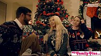 Watch Three people fucking on a Christmas behind a couch preview