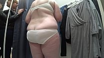 A hidden camera in the changing room peeps at a...