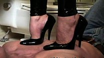 mistress in latex pant s. and face sitting a guy