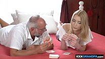 Young blonde playing cards with an old grandpa