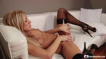 Beautiful blonde puts on some black lingerie wh...