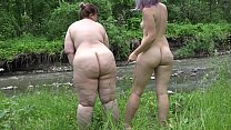 Mutual petting of lesbians on the river bank an...