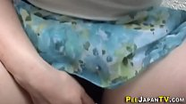 Asian babe pees on thighs