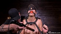 Gagged brunette in device bondage whipped by master Thumbnail