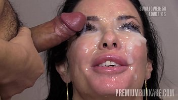 Obedient brunette MILF Veronica Avluv is going to do everything in her power to satisfy as many men as possible in this bukkake scene. Watch the dark-haired hottie swallow over fifty loads and get her bimbo mug drenched in semen.