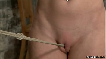 Petite busty brunette slave Serena Blair is walked naked on crotch rope then gets clapmed and vibrated by master Sgt Major on hogtie