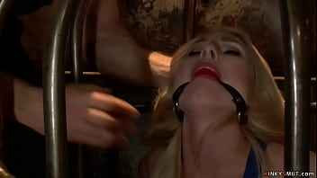Master John Strong pulls out from steel cage sexy blonde slave Christie Stevens and together with big tits Tori Avano anal fucks them in bondage