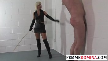 Leather domme spanking her bound subject
