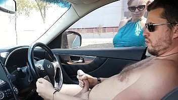 nasty blonde helps him to jerk off his cock in the car and fill his sperm on steering wheel