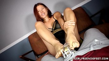 Foot Tease wearing a Chastity Device