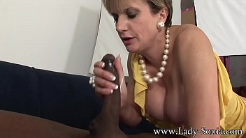 Busty British mature Lady Sonia fucked by a big black dick