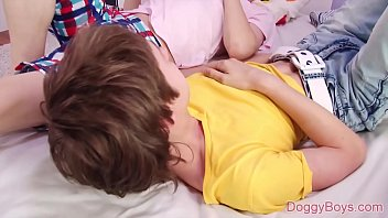 These young twink boys like to get naked together in bed and experiment