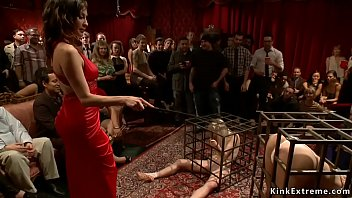 Hot slaves Elyssa Greene and Cherie DeVille are presented in cages at bdsm party of Princess Donna Dolore then they fucked and tormented for public
