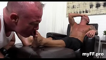 Aroused gay studs in foot fetish romance at home