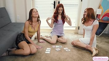 Busty redhead wants to play card game blackjack strip with her teen cousins.They start playing and stripping their clothes.After that,they decide to stop playing and start kissing each other.Next is they lick their wet pussies on the couch.