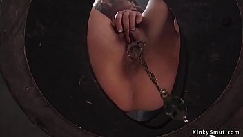 Gagged brunette slut is suspended in bird cage with clamped pussy then old master whips her ass while she sucking dildo then fucks her with big cock