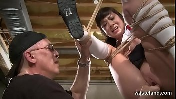 Hanging From A Sex Swing Tied In Ropes This Brunette Sub Is Manipulated To Extreme Orgasm