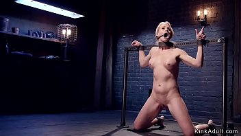 Gagged blonde Milf clamped and made standing on one leg in device bondage